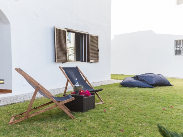 summer apartment garden with chairs and pillows setup